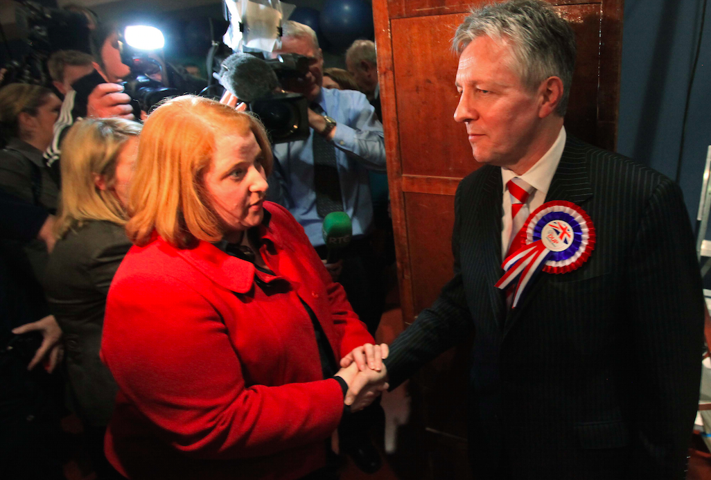 Peter Robinson congratulates Naomi Long on her shock victory in 2010.
