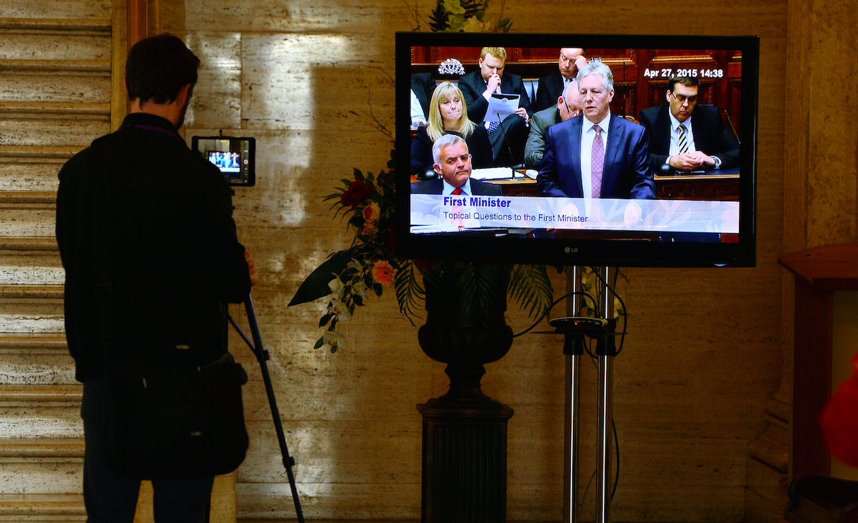 A journalist films in the lobby of Stormont - Northern Ireland's marble floored assembly.